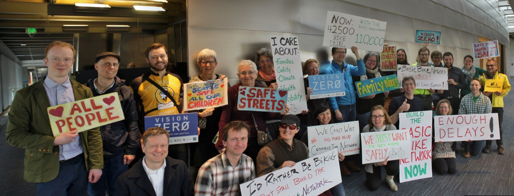Community members stand up for the #BasicBikeNetwork at the Seattle Community Council Transportation Meeting