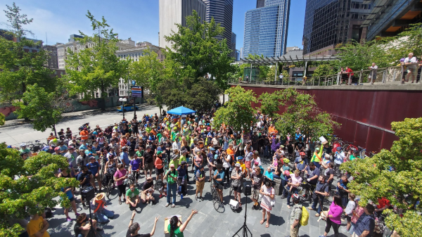 A huge crowd of people stand outside City Hall at the Ride 4 Safe Streets.