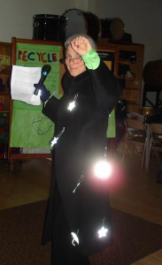 Monica Sweet showing off reflector lights at Safe Routes to School assembly