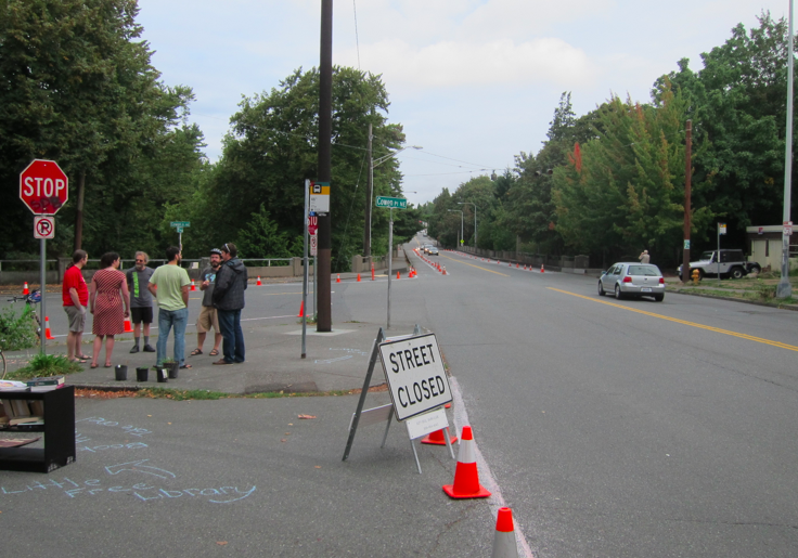 Seattle Neighborhood Greenways groups converted the highly trafficked bridge over Ravenna Park at 15th Ave NE from a four-lane road into a two-laner with biking and walking paths on either side.