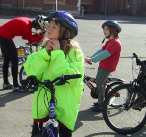Akiva, age 9, enthusiastically gets ready to ride. We need safe healthy streets for our kids!