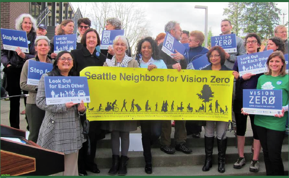 A group of people holding a sign that reads: Seattle Neighbors for Vision Zero.