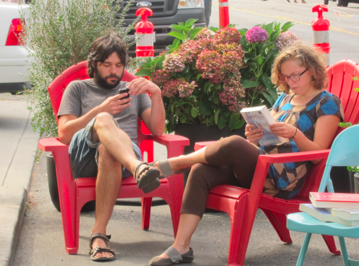 Schemata Workshop designed spot in front of Eltana Bagels in Capitol Hill with books provided by Elliot Bay Bookstore. Here, Tom Fucoloro of Seattle Bike Blog and Kelli Refer, author of Pedal Stretch Breathe take a blogging/reading break.