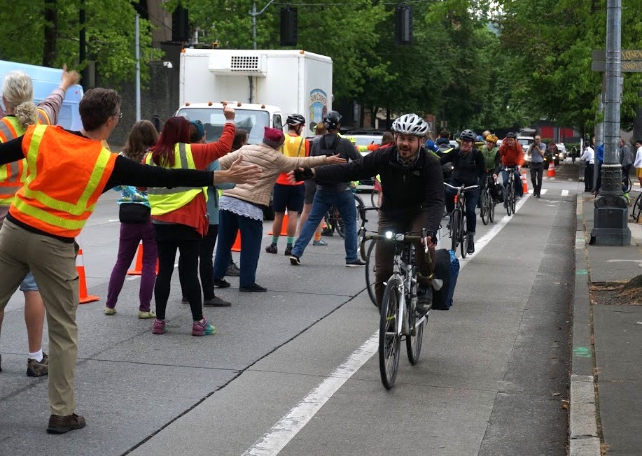 people high fiving through bike lane copy